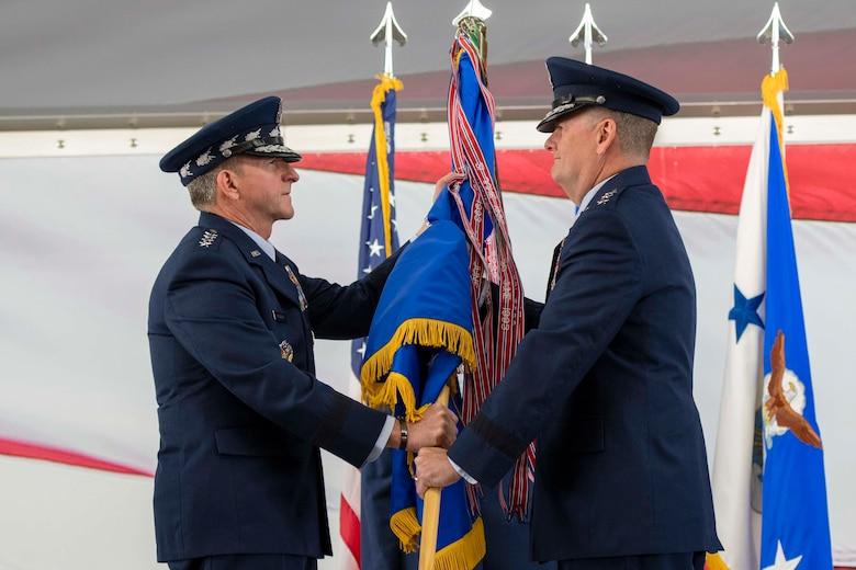 U.S.  Air Force Chief of Staff Gen. David L. Goldfein presents the Air Education and Training Command guidon to Lt. Gen. Brad Webb, new commander of AETC, during a change of command ceremony July 26, 2019, at Joint Base San Antonio-Randolph, Texas. Webb, a 1984 graduate of the U.S. Air Force Academy, is a command pilot with more than 3,700 flying hours, including 117 combat hours in Afghanistan, Iraq and Bosnia. (U.S. Air Force photo by Sabrina Fine)