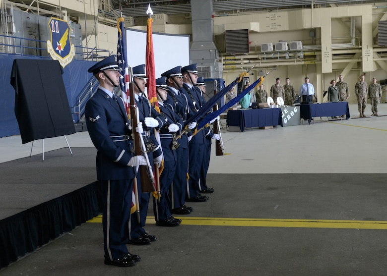 The Joint Base Elmendorf-Richardson honor guard presents the colors during the opening ceremony for the 3rd Wing's 100th anniversary celebration on Joint Base Elmendorf-Richardson, Alaska, July 25, 2019.
