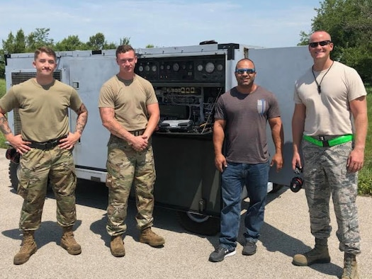 Airmen 1st Class Logan Peters and Devin Julia, Ashkan Serat and Master Sgt. Jeremy Longo, pose for a photo on July 18, 2019. They served as part of a multi-organizational team that spent a week testing potential HVAC replacement units at Whiteman Air Force Base, Missouri. (Courtesy photo)