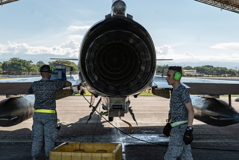 Members of the Colombian Air Force perform maintenance checks on a Kfir fighter jet during Exercise Relámpago in Barranquilla, Colombia, July 17, 2019.