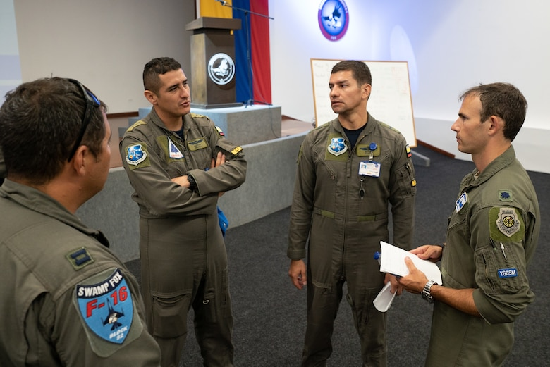 Lt. Col. Stephen Kaminski, 169th Fighter Wing F-16 pilot, speaks with aircrew from the Colombian Air Force during Exercise Relámpago in Barranquilla, Colombia, July 17, 2019.