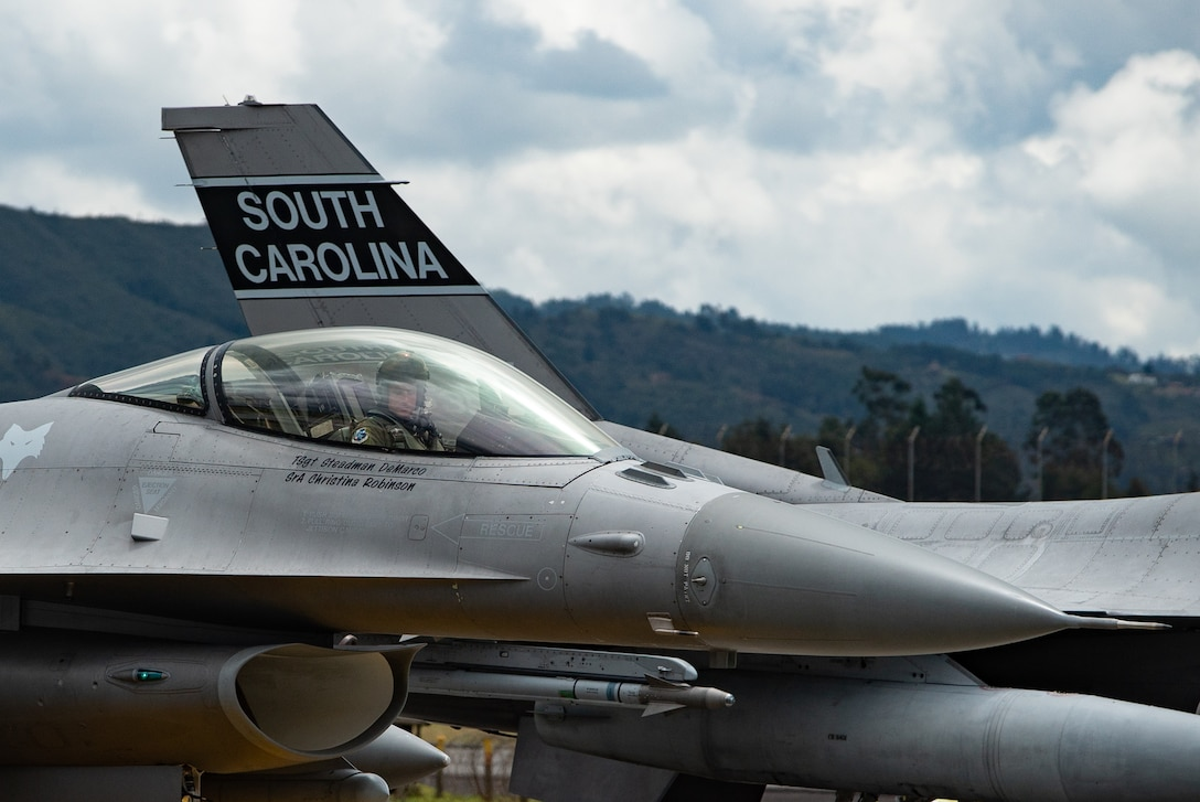 An F-16 pilot from the 169th Fighter Wing, South Carolina Air National Guard, prepares for a flight during Exercise Relámpago in Rionegro, Colombia, July 16, 2019.