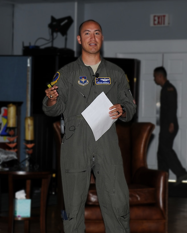 Lt. Col. Earl Arnold, 14th Operations Support Squadron director of operations tells his story at a Storytellers event July 18, 2019, on Columbus Air Force Base, Mississippi. Storytellers originated out of Incirlik Air Base, Turkey, and has grown to become an event held at many Air Force bases all over the world.  (U.S. Air Force photo by Mary Crump)