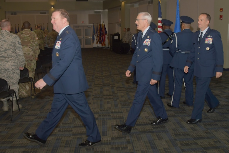 Lt. Gen. Richard W. Scobee, Chief of Air Force Reserve and Air Force Reserve commander, Maj. Gen. Craig L. La Fave, outgoing commander of the 22nd Air Force and Maj. Gen. John P. Healy, incoming commander of the 22nd Air Force, enter a change of command ceremony, July 23, 2019.