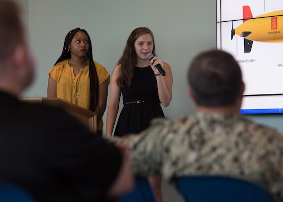 Mikyah Thompson (left), Rutherford High School junior and Anna Rudek (right) Bay High School senior, present their final Science and Engineering Apprenticeship Program presentations to mark the completion of their eight-week summer internship program at Naval Surface Warfare Center Panama City Division July 26.
