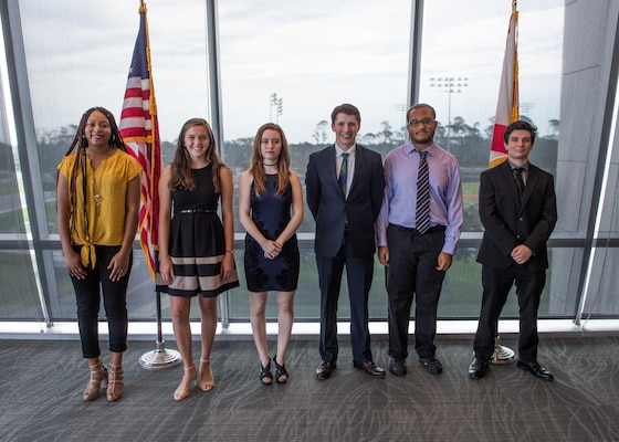Science and Engineering Apprenticeship Program interns pose for a photo presentations to mark the completion of their eight-week summer internship program at Naval Surface Warfare Center Panama City Division July 26.