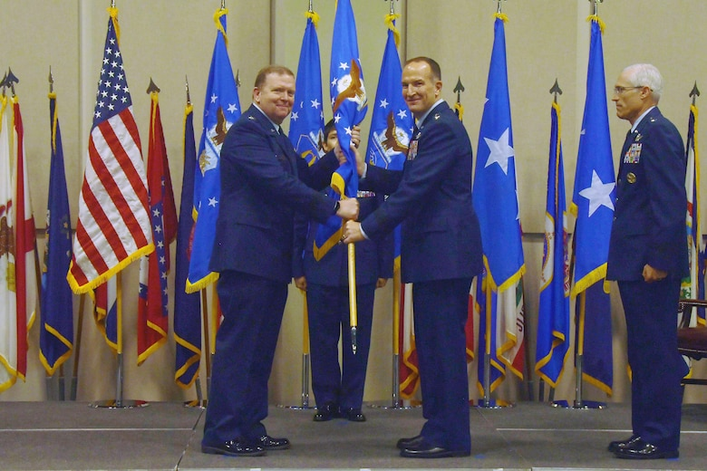 Lt. Gen. Richard W. Scobee, Chief of Air Force Reserve and Air Force Reserve commander, passes the guidon to Maj. Gen. John P. Healy, incoming commander of the 22nd Air Force, during a change of command ceremony July 26, 2019, at Dobbins Air Reserve Base, Ga.