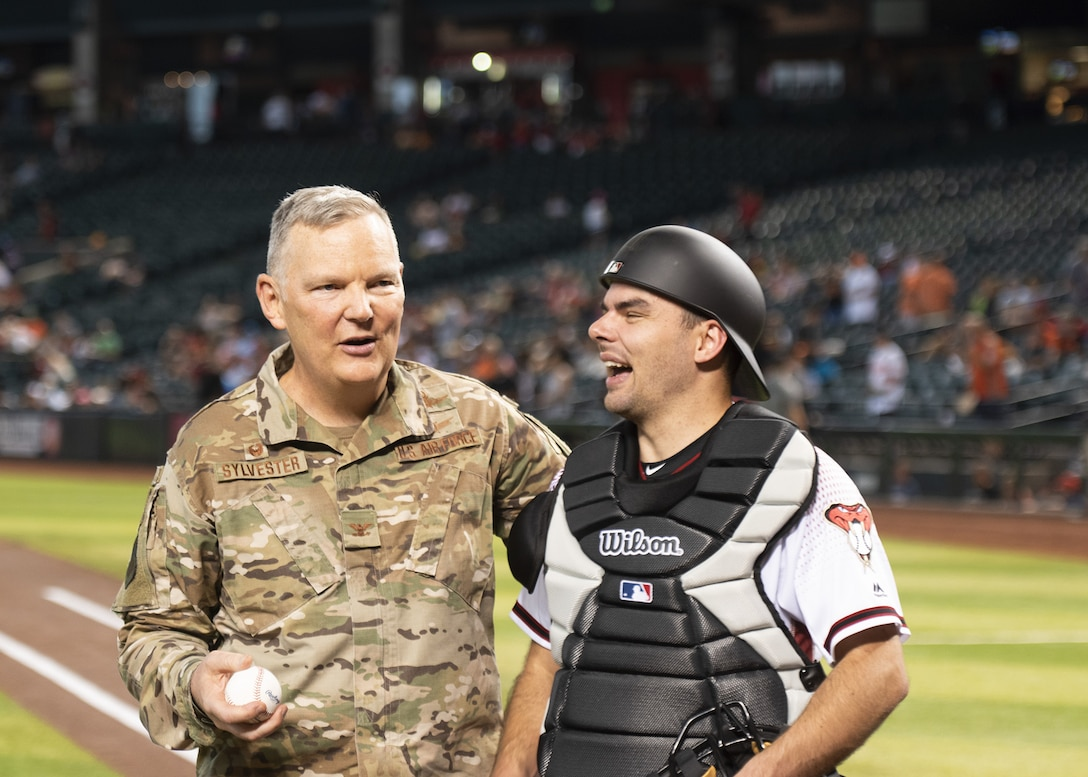 Col. Robert Sylvester, 56th Mission Support Group commander, embraces his son, Robert Sylvester Jr., July 24, 2019, at Chase Field in Phoenix.