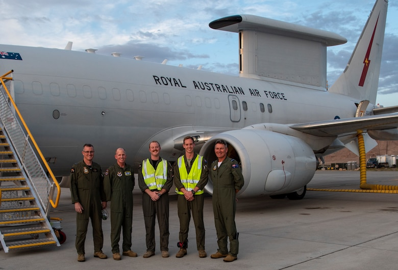 Royal Australian Air Force No. 2 Squadron Wing Commander Jason Brown, Gen. Stephen W. Wilson U.S. Air Force Vice Chief of Staff, RAAF E-7A Wedgetail crew, and Air Commodore Terry Vanharen, Australian Air Attache' pose for a photo on the flightine at Nellis Air Force Base, Nev., July 22, 2019 before a Red Flag mission. Red Flag 19-3 increases interoperability between the U.S. and its allies and across the joint force as Airmen train together against high-end, realistic scenarios. (U.S. Air Force photo by Airman 1st Class Dwane R. Young)