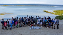 U.S. Navy sailors with 3rd Dental Battalion, 3rd Marine Logistics Group, pose for a group photo with all of the collected trash gathered on the beach following a volunteer beach beautification event July 27, 2019 at Baba Beach Park in Chatan, Okinawa. Approximately 50 sailors volunteered on a Saturday morning to cleanup a local beach and park.