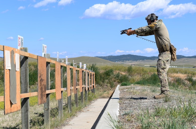 Senior Airman Tyler Arevalo, 741st Missile Security Forces Squadron tactical response force member, fires an M9 pistol July 24, 2019, at Fort Harrison, Mont.