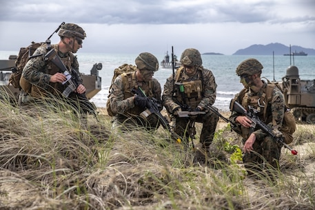 U.S. Marines assess a terrain map during a simulated amphibious assault of exercise Talisman Sabre 19 in Bowen, Australia, July 22, 2019. Talisman Sabre provides an opportunity to conduct operations in a combined, joint and interagency environment that will increase participating countries' abilities to plan and execute contingency responses, from combat missions to humanitarian assistance efforts. (U.S. Marine Corps photo by Lance Cpl. Tanner D. Lambert