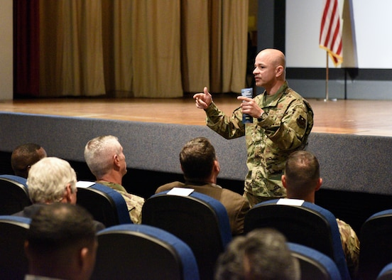 U.S. Air Force Col. Andres Nazario, 17th Training Wing commander, speaks to members of the Goodfellow team about ways he hopes to improve the base environment during a commander's call at the base theater on Goodfellow Air Force Base, Texas, July 25, 2019. Nazario challenged the attendees to be leaders and revolutionaries in their respective career fields. (U.S. Air Force photo by Airman 1st Class Robyn Hunsinger/Released)