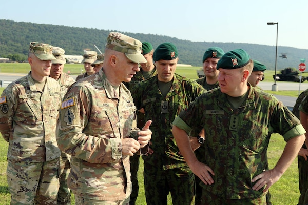 Col. Andrew Inch, 28th Infantry Division chief of staff, talks to Lithuanian Land Forces Army Col. Zilvinas Gaubys, LLF chief of staff, during a tour of monuments at Fort Indiantown Gap July 26, 2019.