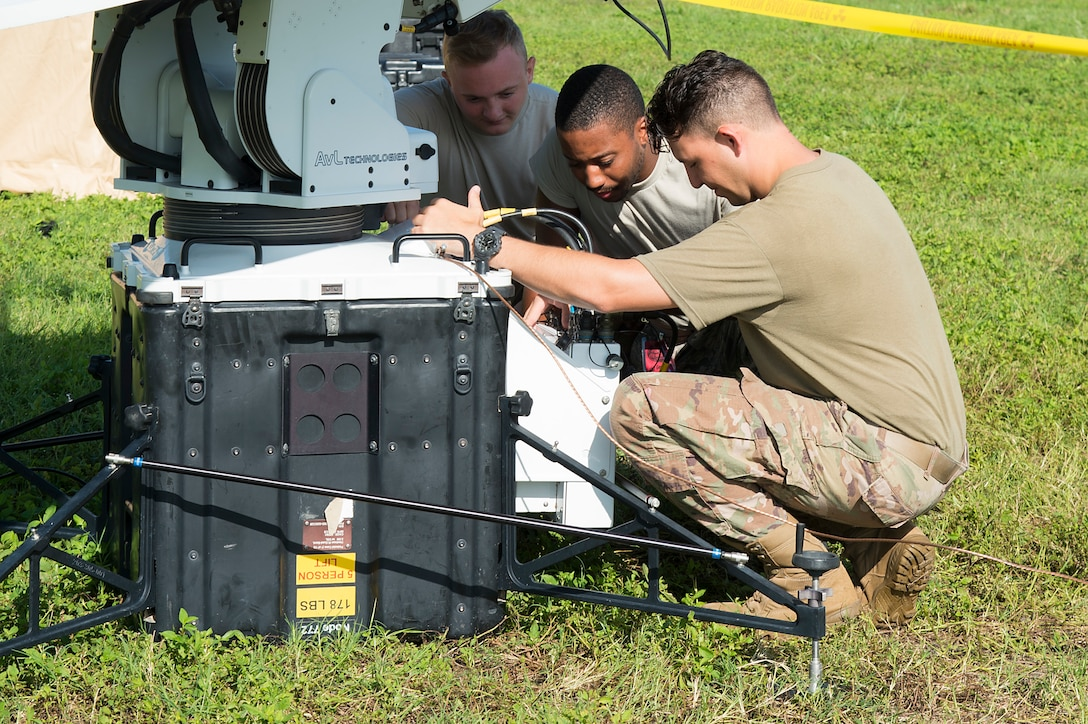 U.S. Air Force Airman 1st Class Caleb Shumaker, Airman 1st Class Andree Dixson and Airman 1st Class Andrew Knudsvig, 27th Special Operations Communication Squadron, expeditionary cyber operations technicians, test a satellite communications system, July 18, 2019, at MacDill Air Force Base, Fla.