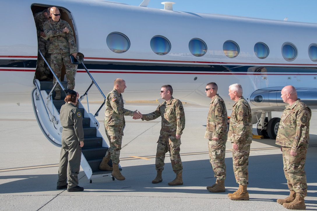 U.S. Army Gen. Steve Lyons, U.S. Transportation Command commander, Scott Air Force Base, Illinois, is welcomed by Col. Jeffrey Nelson, 60th Air Mobility Wing commander, July 24, 2019, at Travis Air Force Base, California. Lyons interacted with Travis Airmen and toured several units while on the base visit. (U.S. Air Force photo by Heide Couch)