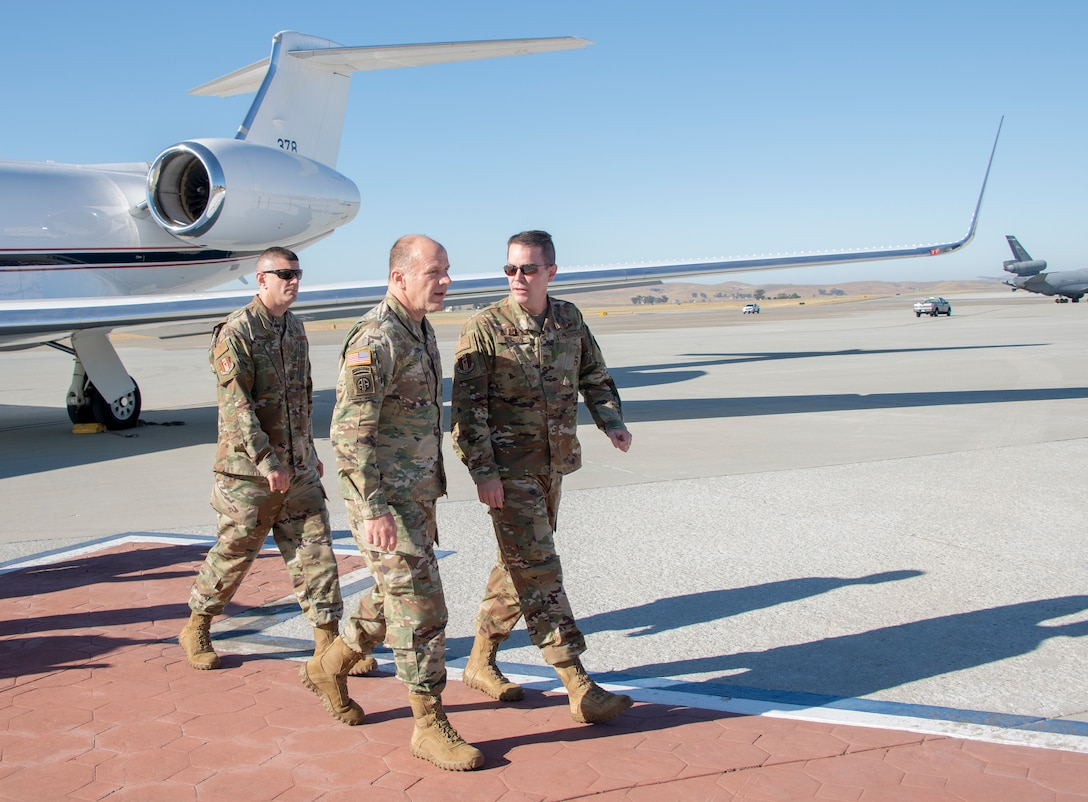 U.S. Army Gen. Steve Lyons, U.S. Transportation Command commander, Scott Air Force Base, Illinois, is escorted by Col. Jeffrey Nelson, 60th Air Mobility Wing commander, and Chief Master Sgt. Derek Crowder, 60th AMW command chief, July 24, 2019, at Travis Air Force Base, California. Lyons interacted with Travis Airmen and toured several units while on the base visit. (U.S. Air Force photo by Heide Couch)