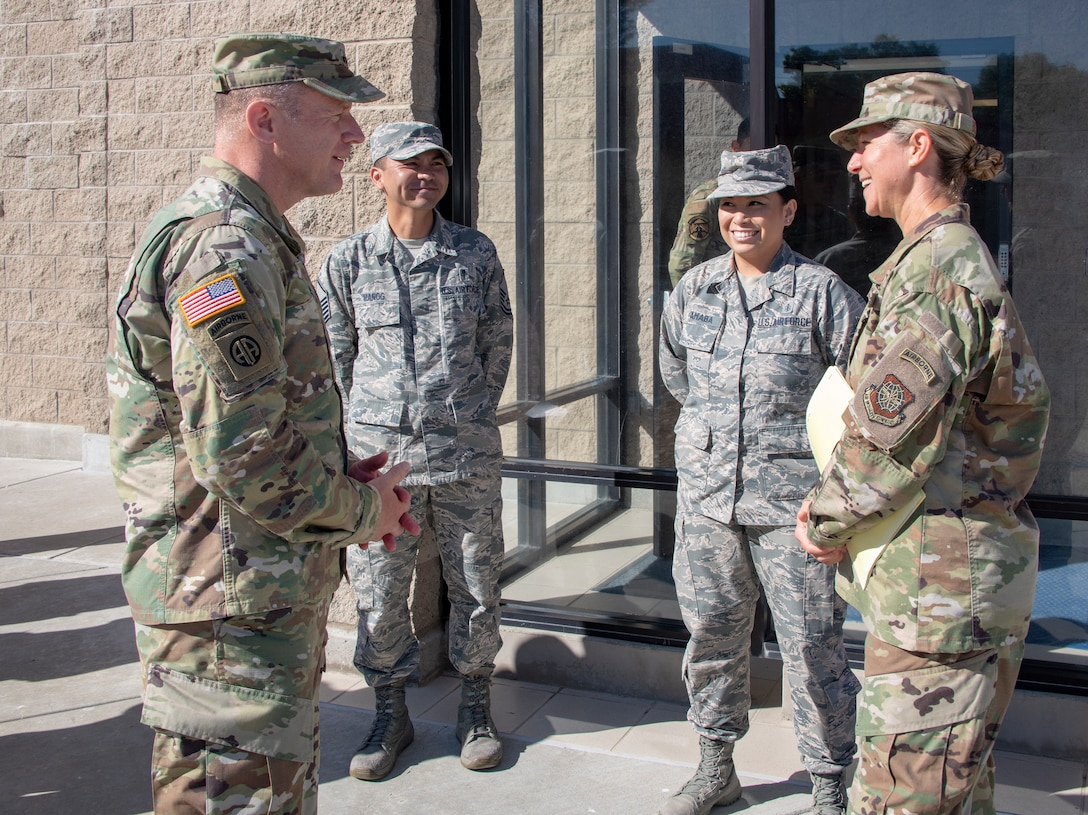 U.S. Army Gen. Steve Lyons, left, U.S. Transportation Command commander, Scott Air Force Base, Illinois, speaks with Col. Kristen Beals, right, 60th Medical Group commander, July 24, 2019 at Travis Air Force Base, California. Lyons had the opportunity to interact with Travis Airmen and tour several units while on the base visit. (U.S. Air Force photo by Heide Couch)