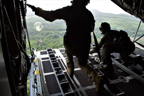 A C-130H Hercules crew assigned to the 182d Airlift Wing, Peoria Air National Guard Base, Illinois, flies over Rogers City, Michigan, July 25, 2019, on an integrated air drop training mission during exercise Northern Strike 19.