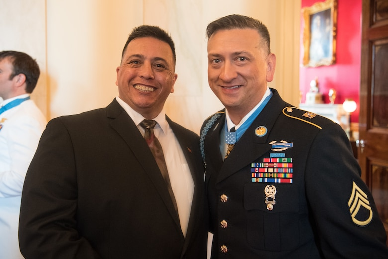 Former U.S. Army Staff Sgt. David G. Bellavia, and his Army Recruiter Retired Sgt. 1st Class Gustavo Reina in Washington, D.C., June 25, 2019. Bellavia was awarded the Medal of Honor June 25, 2019, for actions while serving as a squad leader with the 1st Infantry Division in support of Operation Phantom Fury in Fallujah, Iraq when a squad from his platoon became trapped by intense enemy fire. (U.S. Army Photo by Sgt. Kevin Roy)