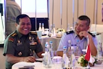 Hawaii Air National Guard Lt. Col. Frances T. Shen, Senior State Partnership Program Cyber Lead, and Tentara Nasional Indonesia Army Col. Achmad Budi Handoyo, Senior Staff Officer for Joint Exercise Operations Staff TNI HQ, have a discussion prior to opening remarks of the 2019 Information System and Technology Exchange, July 22, 2019, Jakarta, Indonesia. This year's third annual ISTX falls under the Hawaii National Guard's State Partnership Program, and aims to share best practices, assist in cybersecurity doctrine development, and enhance the cybersecurity capabilities to effectively defend and protect critical cyber information infrastructure from malicious virus and cyber intrusion.
