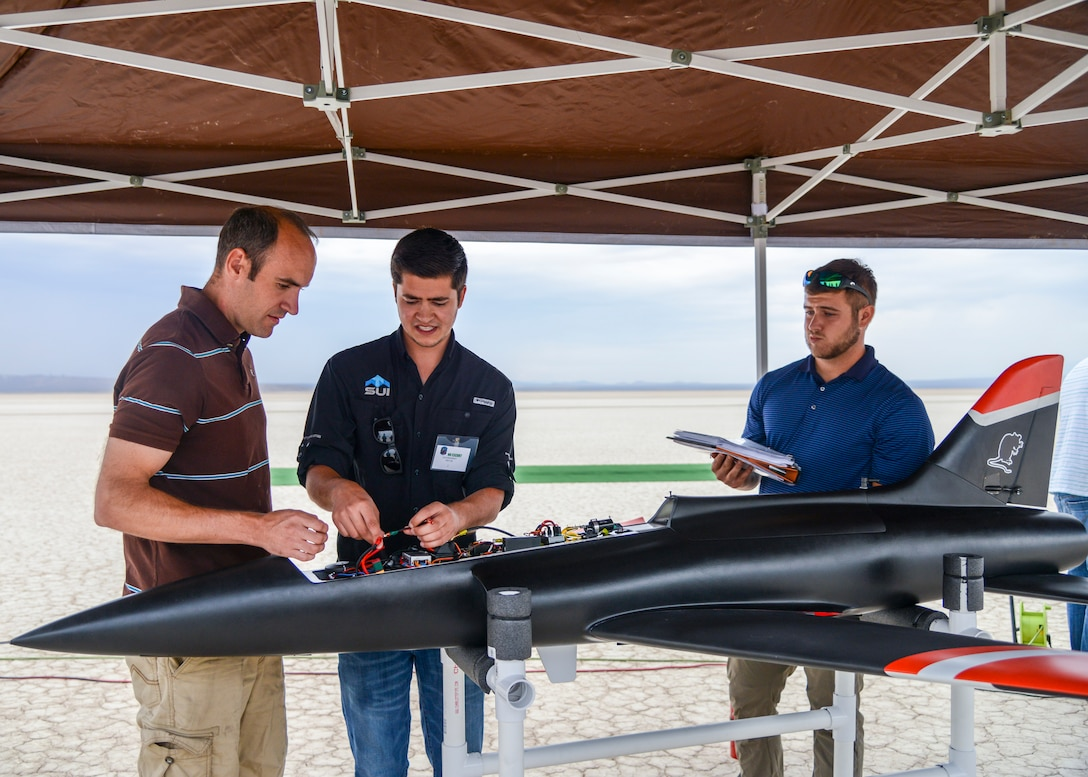 Engineers prepare an unmanned jet-powered aircraft for a flight test at Edwards Air Force Base, Calif., July 25. The flight tested a software suite called TACE, Testing Autonomy in a Complex Environment, developed by John Hopkins Applied Physics Lab. (U.S. Air Force photo by Giancarlo Casem)