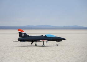 An unmanned jet-powered aircraft takes off from dry lake bed at Edwards Air Force Base, Calif., July 25. The flight tested a software suite called TACE, Testing Autonomy in a Complex Environment, developed by John Hopkins Applied Physics Lab. (U.S. Air Force photo by Giancarlo Casem)