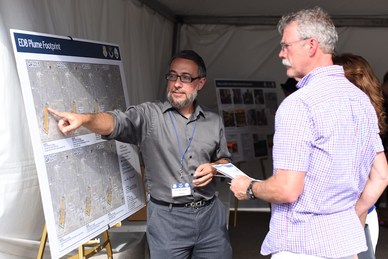 Ben Moayyad, U.S. Army Corps of Engineers project manager, explains the results of the bulk fuels contamination leak cleanup project to attendees of an open house at Kirtland Air Force Base, N.M., July 25, 2019. The open house gave the public a chance to see the treatment facility, learn about and ask questions about the cleanup process. (U.S. Air Force photo by Senior Airman Eli Chevalier)
