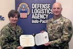 Army Capt. Ryan Campbell, a joint logistics plans officer for DLA Indo-Pacific, receives a Joint Service Achievement Medal in July at Joint Base Pearl Harbor-Hickam, Hawaii, from DLA Indo-Pacific Commander Navy Capt. Kristin Acquavella for his support during Pacific Sentry.