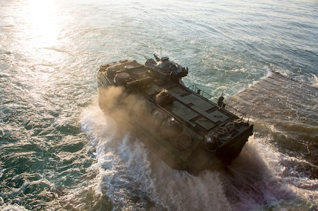 U.S. Marines with Golf Company, Battalion Landing Team, 2nd Battalion, 8th Marine Regiment, 26th Marine Expeditionary Unit (MEU), conduct ship-to-shore movements utilizing amphibious assault vehicles (AAV) from Harpers Ferry-class dock landing ship USS Oak Hill (LSD 51) during Amphibious Squadron (PHIBRON) MEU Integration Training (PMINT) in vicinity of Camp Lejeune, North Carolina, July 15 2019. PMINT is part of the 26th MEU's and PHIBRON 8's pre-deployment training program, which enhances interoperability and familiarizes Marines and Sailors to life on ship prior to deployment. (U.S. Marine Corps photo by Cpl. Nathan Reyes)