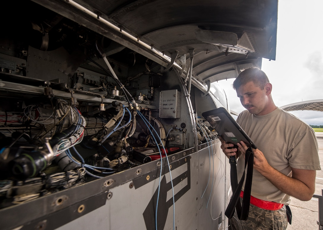 Senior Airman Andrew Bobick, 75th Aircraft Maintenance Unit avionics journeyman, reads a technical order during a sortie surge exercise, July 24, 2019, at Moody Air Force Base, Ga. The exercise was conducted to determine Airmen's abilities to perform effectively while generating combat or training sorties at an accelerated rate. Throughout the four-day surge, pilots and maintainers completed 131 sorties spanning approximately 152 flying hours. (U.S. Air Force photo by Airman 1st Class Eugene Oliver)