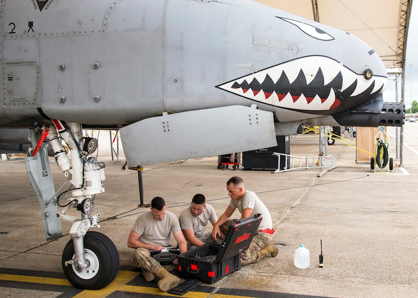 Airmen from the 75th Aircraft Maintenance Unit read a technical order during a sortie surge exercise, July 24, 2019, at Moody Air Force Base, Ga. The exercise was conducted to determine Airmen's abilities to perform effectively while generating combat or training sorties at an accelerated rate. Throughout the four-day surge, pilots and maintainers completed 131 sorties spanning approximately 152 flying hours. (U.S. Air Force photo by Airman 1st Class Eugene Oliver)