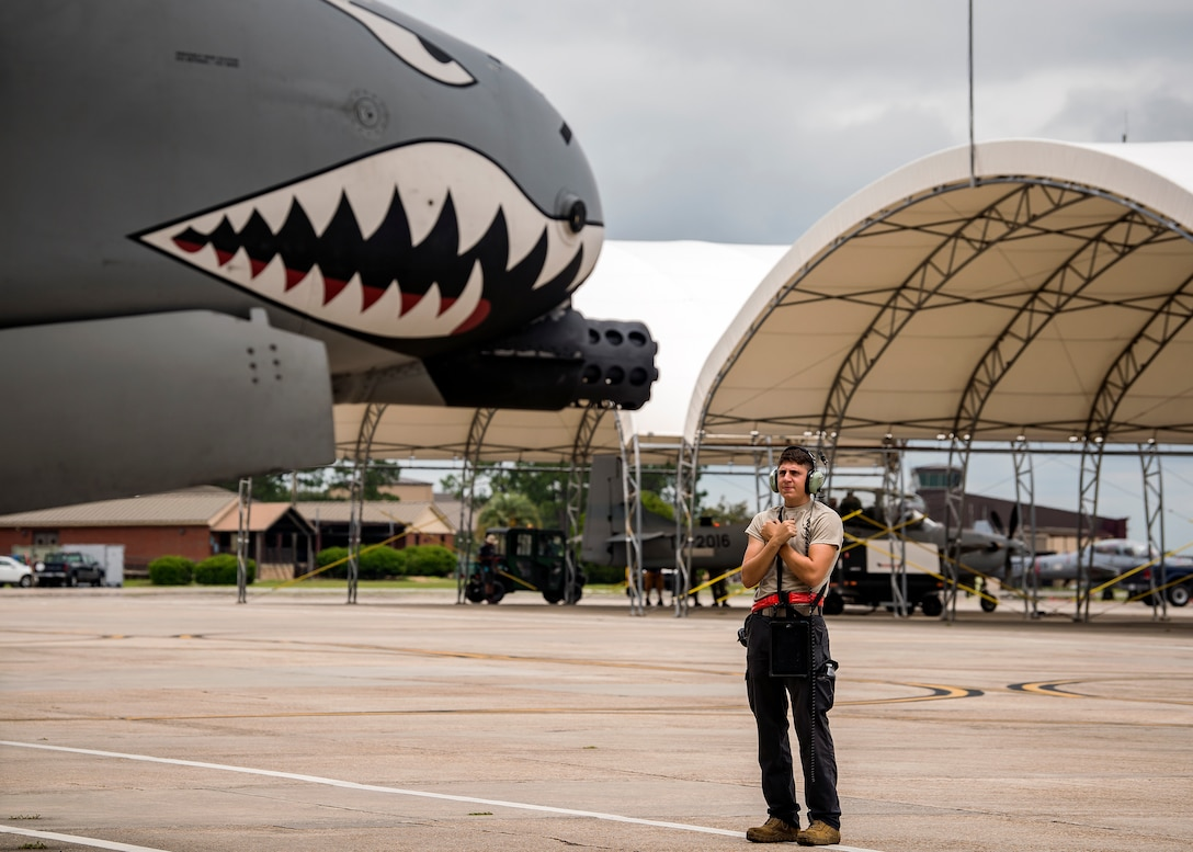 Senior Airman Mitch Yuncker, 75th Aircraft Maintenance Unit crew chief, marshals an A-10C Thunderbolt II onto the taxiway during a sortie surge exercise, July 24, 2019, at Moody Air Force Base, Ga. The exercise was conducted to determine Airmen's abilities to perform effectively while generating combat or training sorties at an accelerated rate. Throughout the four-day surge, pilots and maintainers completed 131 sorties spanning approximately 152 flying hours. (U.S. Air Force photo by Airman 1st Class Eugene Oliver)