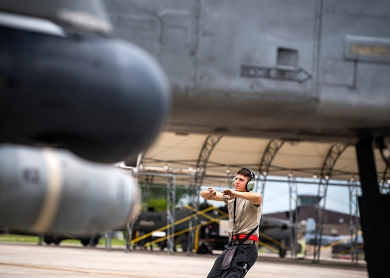 Airman 1st Class Corbin Anderson, 75th Aircraft Maintenance Unit crew chief, marshals an A-10C Thunderbolt II onto the taxiway during a sortie surge exercise, July 24, 2019, at Moody Air Force Base, Ga. The exercise was conducted to determine Airmen's abilities to perform effectively while generating combat or training sorties at an accelerated rate. Throughout the four-day surge, pilots and maintainers completed 131 sorties spanning approximately 152 flying hours. (U.S. Air Force photo by Airman 1st Class Eugene Oliver)