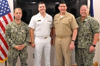 IMAGE: DAHLGREN, Va. (July 17, 2019) – U.S. Naval Academy Midshipman Max Shuman is pictured with the officers he briefed on his Naval Surface Warfare Center Dahlgren Division internship at the command's Laser Lethality and Development Facility which features an above-ground tunnel used for evaluating high energy laser weapon systems. Pictured left to right: Lt. Adam Mattison, Shuman, Cmdr. Steven Perchalski, and Lt. Paul Cross.