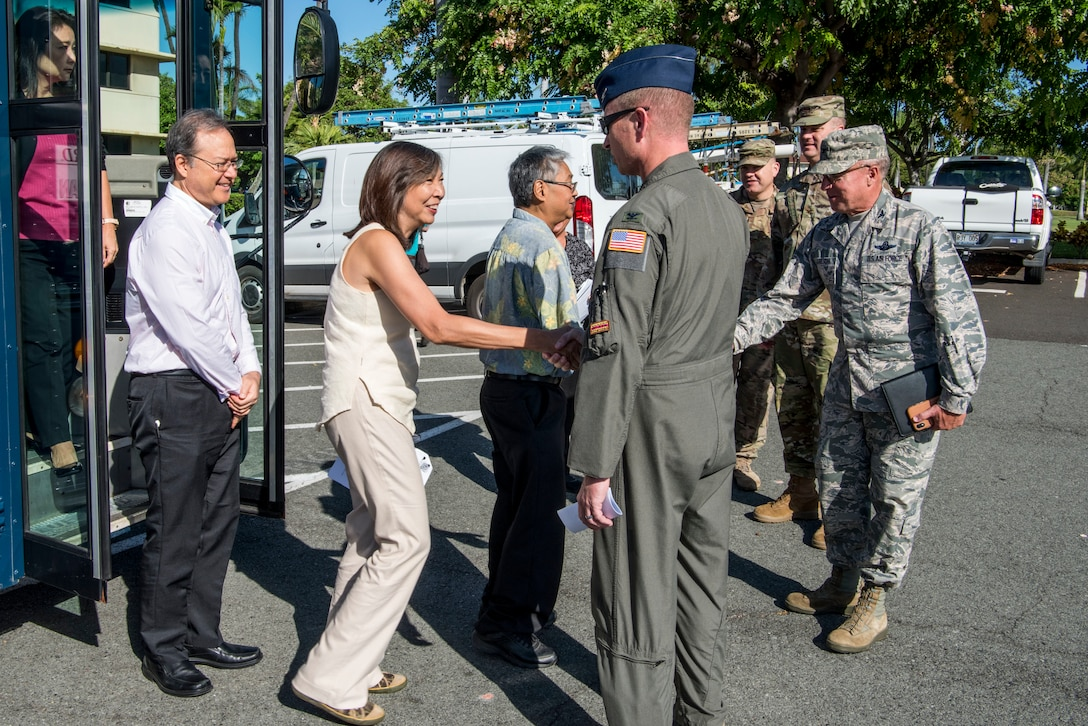 U.S. Air Force leadership greet Hawaii State Legislative representatives in front of the Pacific Air Forces Headquarters July, 24, 2019. Eleven Hawaii legislatures visited with U.S. Air Force representatives in an effort to broaden understandings of Air Force missions, capabilities, roles and responsibilities. (U.S. Air Force photo by Staff Sgt. Jack Sanders)