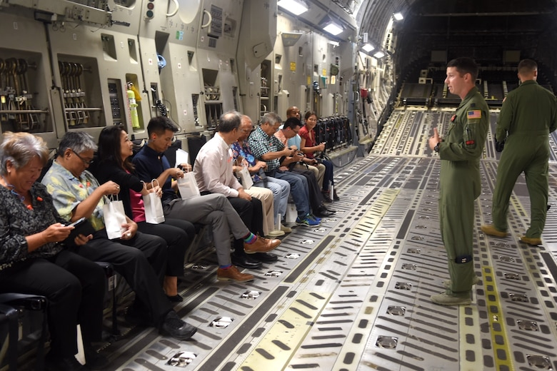 U.S. Air Force Airmen explain the mission and capabilities of a C-17 Globemaster III to Hawaii State Legislative representatives during a familiarization flight July, 24, 2019. Eleven Hawaii legislatures visited with U.S. Air Force representatives in an effort to broaden understandings of Air Force missions, capabilities, roles and responsibilities. (U.S. Air Force photo by 1st Lt. Amber Kelly-Herard)