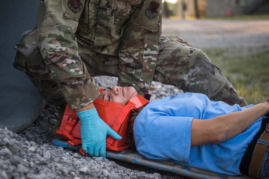 Members of the Joint Military Medical Team (Colorado National Guard, Michigan Air National Guard, and Latvia Military) simulate close quarter casualty training, Alpena Combat Readiness Training Center, Michigan, July 23, 2019. Northern Strike 19 is a National Guard Bureau-sponsored exercise uniting service members from more than 20 states, multiple service branches and numerous coalition countries during the last two weeks of July 2019 at the Camp Grayling Joint Maneuver Training Center and the Alpena Combat Readiness Training Center, both located in northern Michigan and operated by the Michigan National Guard. The accredited Joint National Training Capability exercise demonstrates the Michigan National Guard's ability to provide accessible, readiness-building opportunities for military units from all service branches to achieve and sustain proficiency in conducting mission command, air, sea and ground maneuver integration, together with the synchronization of fires in a joint, multinational, decisive action environment. (Air National Guard photo by Senior Airman Gary Leonard)
