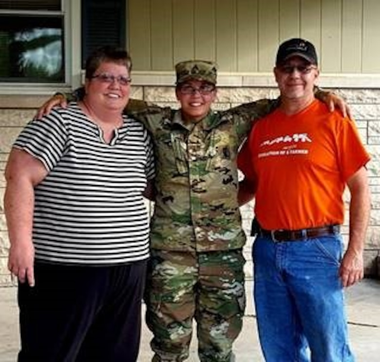 Staff Sgt. Ashley Munger, AGR Army recruiter, Shellbyville Army Recruiting Station, Indiana, with her parents Glenda and Steve Munger.