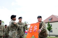 232nd Signal Company's guidon is unrolled, signifying the company's official activation