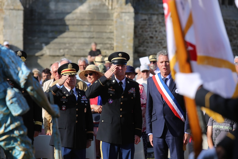 Brig. Gen. Michael T. Harvey, commanding general of the 7th Mission Support Command, and Col. James Bramble salute the Four Braves Memorial in Periers, France on July 27, 2019 after laying a wreath in remembrance of the American Soldiers who fought and died to liberate towns like Periers during Operation Overlord in World War II. The 90th Infantry Division, now the 90th Sustainment Brigade, liberated the town seven weeks after landing on Utah beach just 35 kilometers away. (U.S. Army Reserve Photo by Capt. Joe Bush)