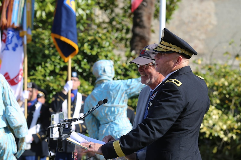 Brig. Gen. Michael T. Harvey, commanding general of the 7th Mission Support Command, embraces Christian Lavaufre, Chairman of the Normandy 44-90th Infantry Division Association, while giving a speech during the 75th Anniversary ceremony of the liberation of Periers, France on July 27, 2019. The 90th Infantry Division, now the 90th Sustainment Brigade, liberated the town during World War II seven weeks after landing on Utah beach just 35 kilometers away. (U.S. Army Reserve Photo by Capt. Joe Bush)