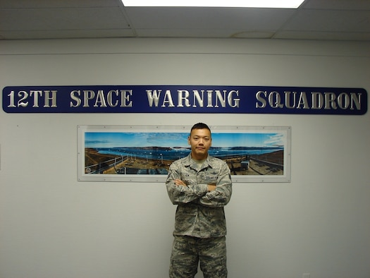 Staff Sgt. Yakov Kim, 12th Space Warning Squadron crew chief, poses for a photo at Thule Air Base, Greenland, July 25, 2019. Kim was born in Uzbekistan just before the collapse of the Soviet Union and has used his experiences to share resilience at his current duty station. (U.S. Air Force courtesy photo)