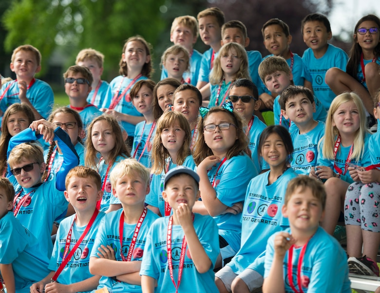 Students from STARBASE Minnesota watch rockets blast off from the launch pad in St. Paul, Minn., July 18, 2019.