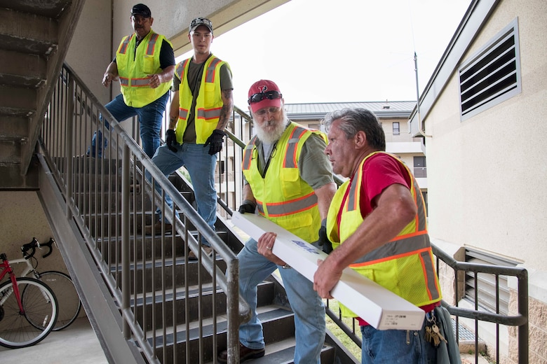 Professionals from the 502nd Air Base Wing Civil Engineer Group work to remediate dorms with mold on Monday, July 29, 2019 and Joint Base San Antonio–Lackland. The mold remediation is taking place after Airmen at JBSA-Lackland voiced their concerns. (U.S. Air Force photo by Sean Worrell)