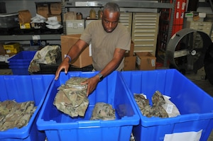 Senior Master Sgt. Anthony Brown, 403rd Logisitics Readiness Squadron logistics supply manager, separates the new Operational Camouflage Pattern uniforms by size in order to fill uniform orders as required. The new uniforms will be mandatory wear by April 1, 2021, with deploying members being the first to receive the uniform. (U.S. Air Force photo by Jessica L. Kendziorek)