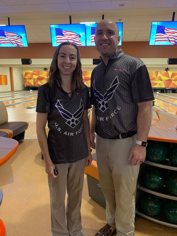 Veteran Air Force keglers, Maj. Danielle Crowder, formerly of the Air Force Office of Special Investigations Judge Advocate General's office, now Maxwell Air Force Base, Ala., and Staff Sgt. James McTaggart from Creech AFB, Nev., captured the Mixed Doubles title at the Armed Forces Bowling Championships at Naval Station Great Lakes, Ill., July 23, 2019. (Photo by NPASE MW)