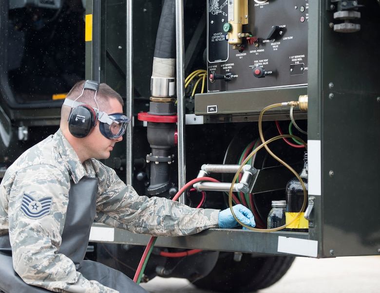 U.S. Air Force Tech. Sgt. Dustin Legatt, a fuels specialist with the 133rd Petroleum, Oil and Lubricants Flight, monitors the quality control of the in-line sampler in St. Paul, Minn., July 10, 2019.