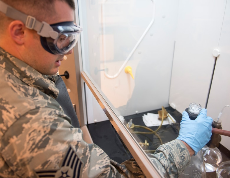 U.S. Air Force Tech. Sgt. Dustin Legatt, a fuels specialist with the 133rd Petroleum, Oil and Lubricants Flight, removes residual from JET-A fuel from the filter monitor in St. Paul, Minn., July 10, 2019.