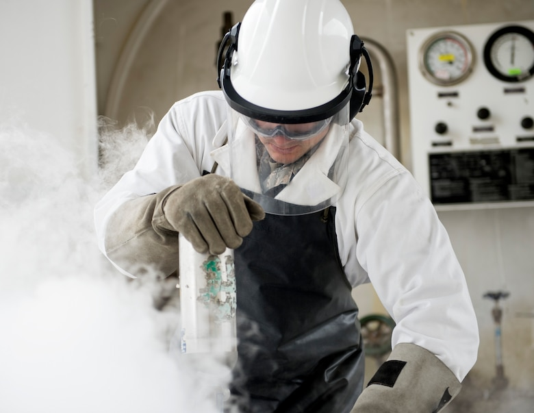 U.S. Air Force Tech. Sgt. Dustin Legatt, a fuels specialist with the 133rd Petroleum, Oil and Lubricants Flight, waits for the cryogenic cylinder to pressurize in St. Paul, Minn., July 10, 2019.